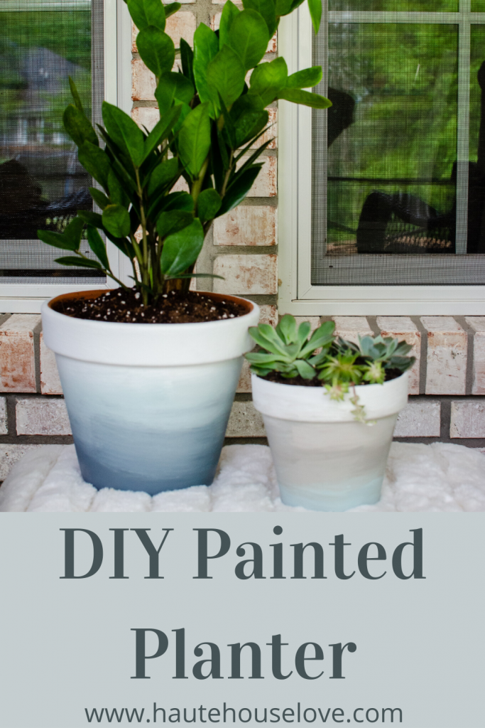 This is an ombre painted terra cotta flower pot using white and blue paint.