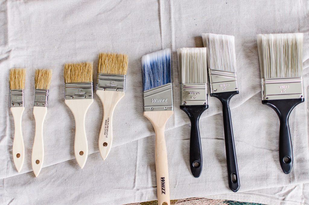 Various sizes of paint brushes for painting terracotta pots.