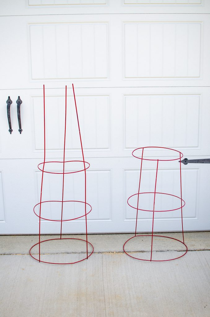 tomato cages for diy plant stand on ground in front of garage door