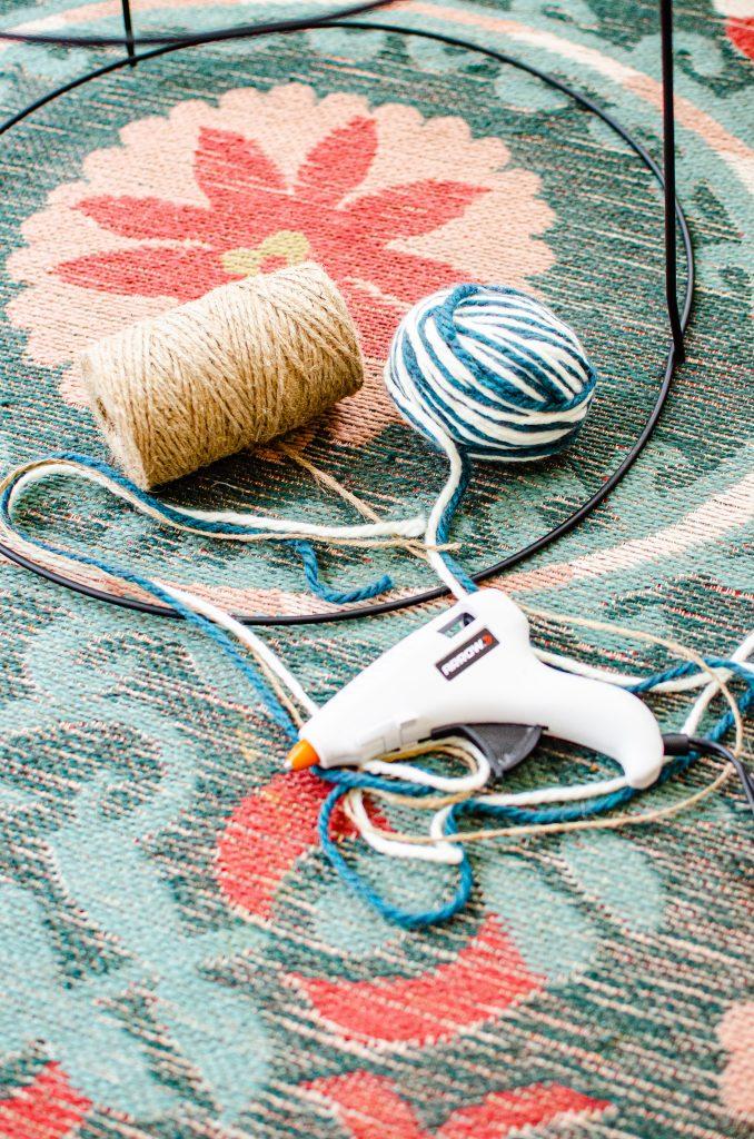 diy plant stand materials; yarn, jute twine and a hot glue gun