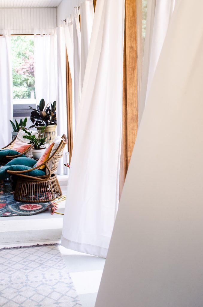DIY Beaded Tassel Tie Back, white curtains on outdoor patio | HauteHouseLove.com