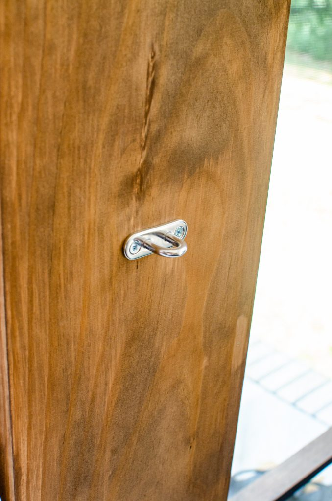 Metal ring hook on outdoor patio post for curtain tie backs | HauteHouseLove.com