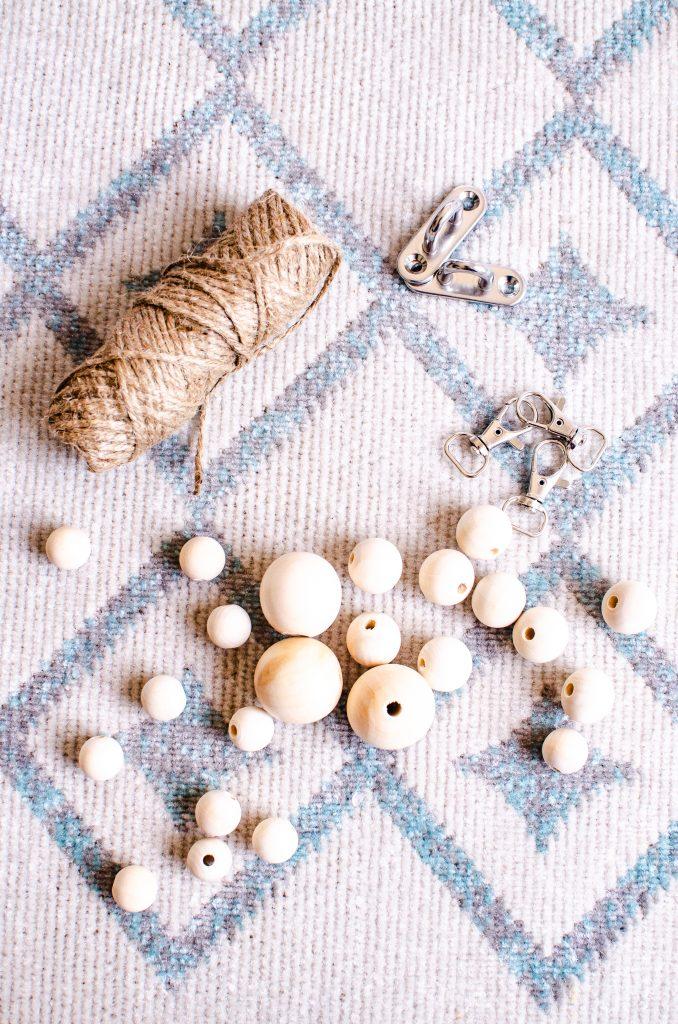 Jute rope, metal hooks, carabiners, natural wood beads / HauteHouseLove.com