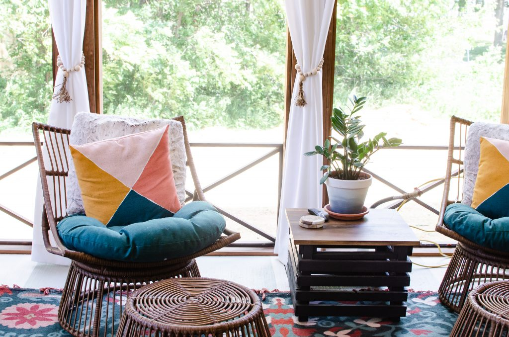 Boho style home decor, bright colored pillows on outdoor chairs for back patio | Found on HauteHouseLove.com
