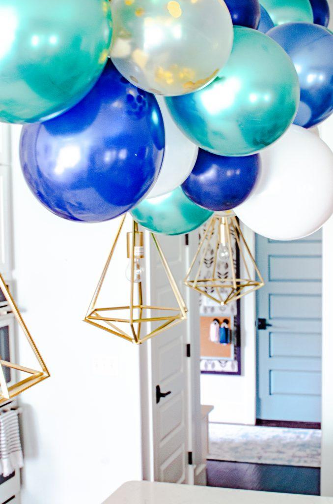 blue and green diy balloon garland | HauteHouseLove.com