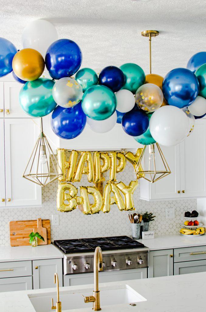 birthday balloon garland decor in kitchen