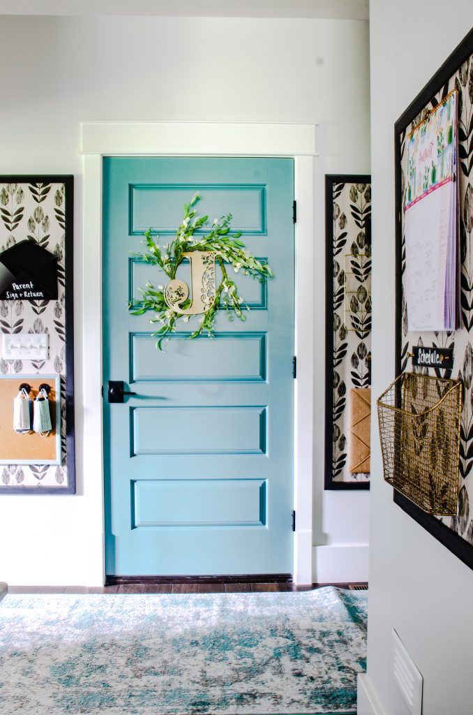 Garage Entry with colorful door and organized command center