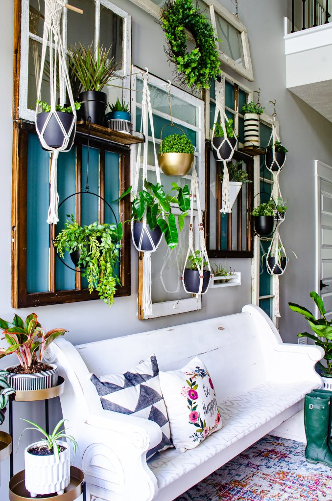Hanging plant wall in two story entry