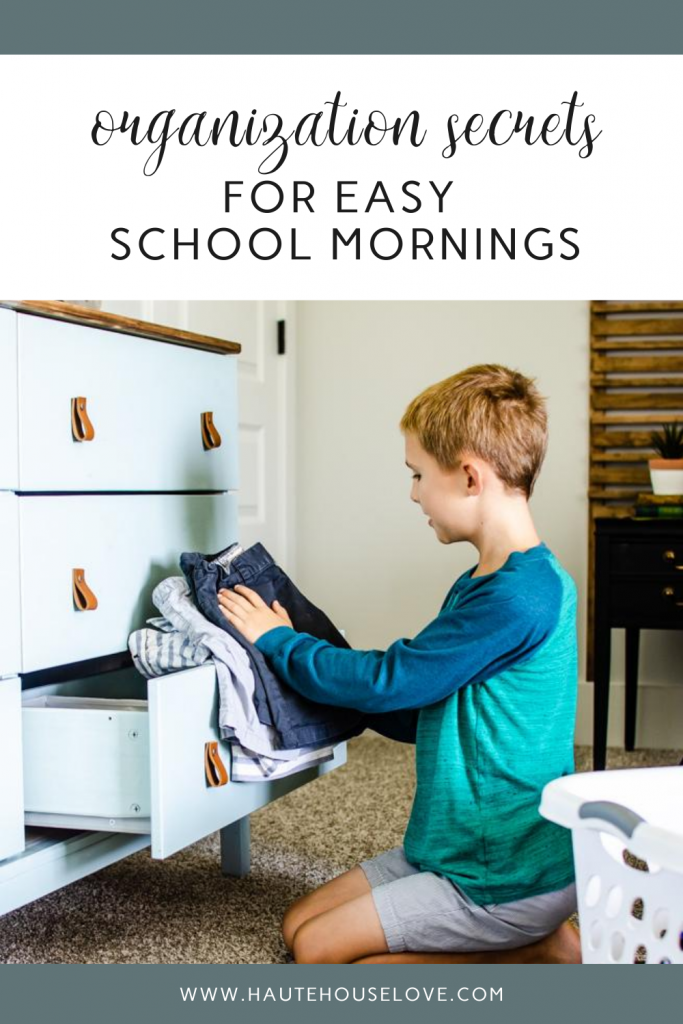 child putting away laundry