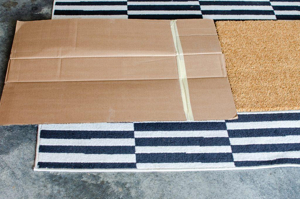 Cardboard on Rug for DIY Doormat