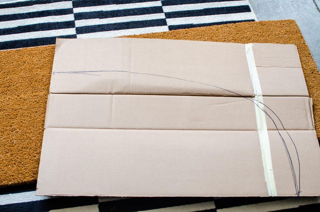 Cardboard on Rug for DIY Doormat Template