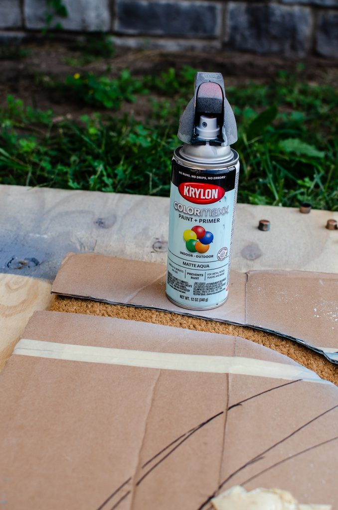 Can of Spray Paint and Cardboard for DIY Doormat Template