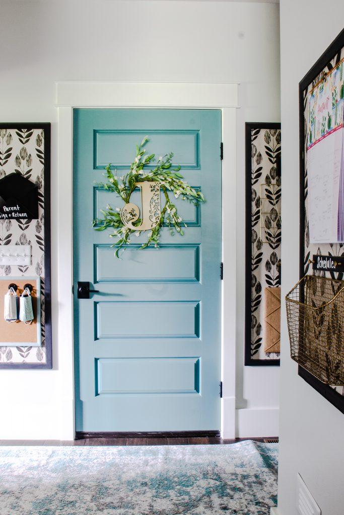 Unique Wallpaper in Organized Hallway.