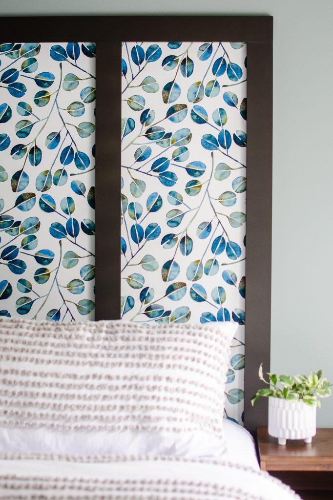 Blue eucalyptus wallpaper faux headboard in a master bedroom