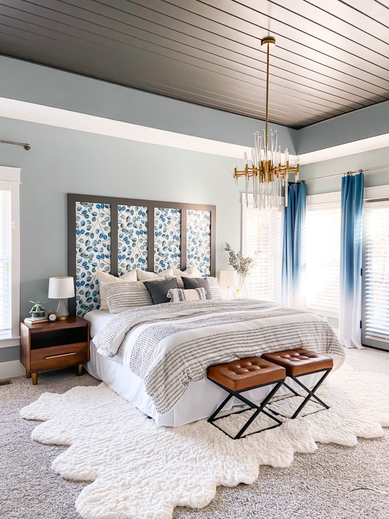 Cozy serene bedroom in blue and bronze shades