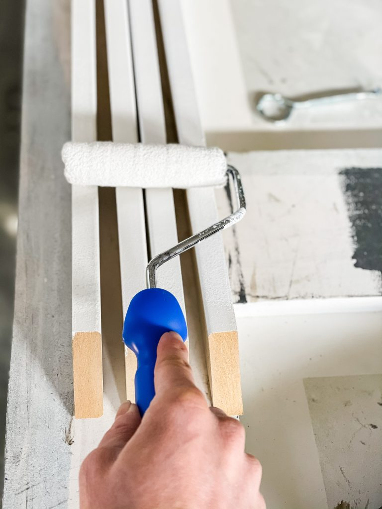 painting slat wall boards with a white paint