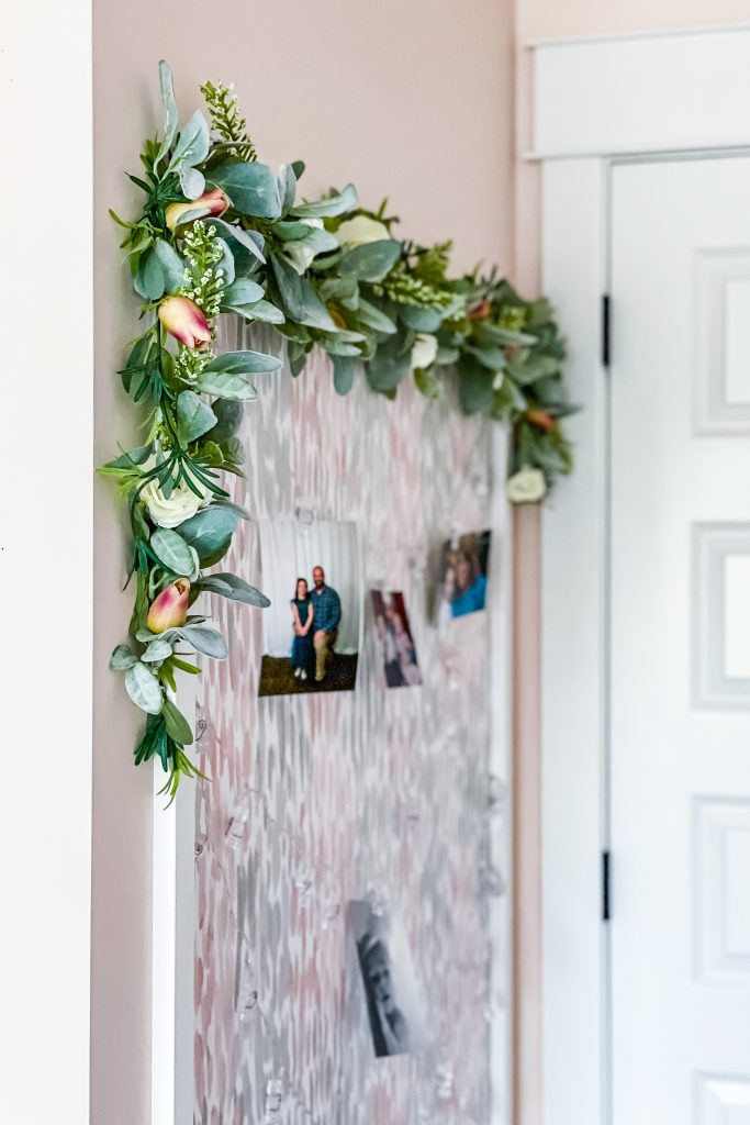 Easy Wood Frame for Beginner DIY Projects on HauteHouseLove.com | Pink Wall, Faux Greenery Swag, Photo Board