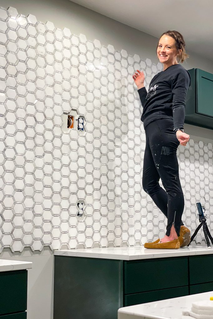 Hanging Jeffrey Court Norton Mosaic Tile on a backsplash wall.