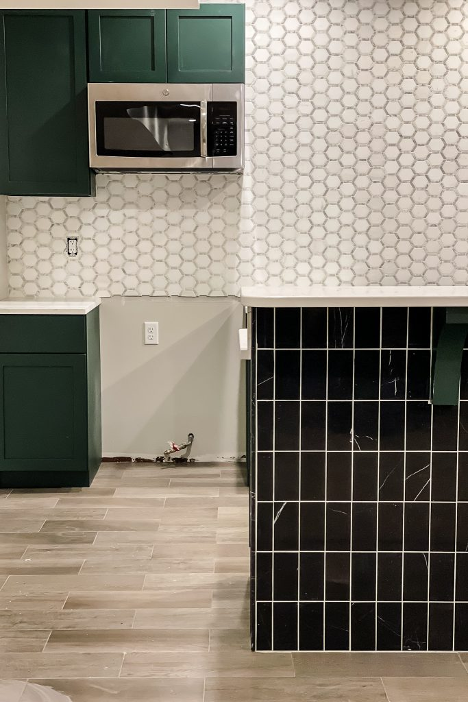 Basement Bar Designed with black and white tile by Jeffrey Court.