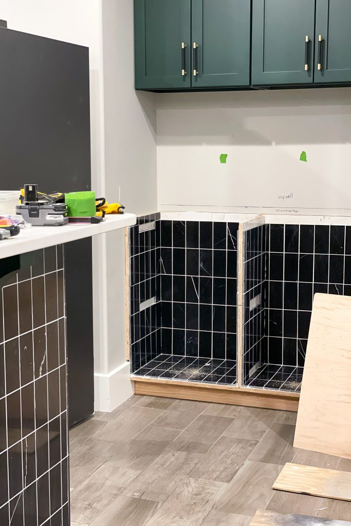 A wine bar being built with Jeffrey Court tile.