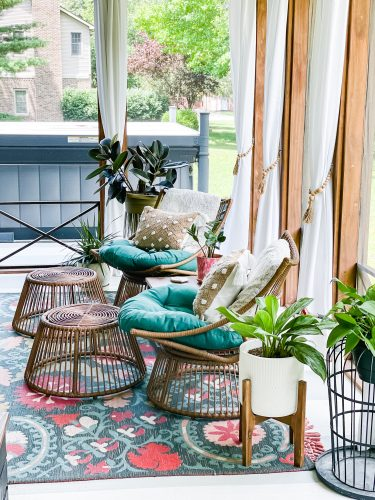 Back Porch Refresh with white hanging curtains, wicker furniture and outdoor plants, modern boho design   The Weekender on HauteHouseLove.com