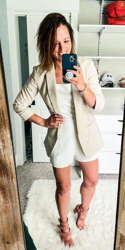 mirror selfie of womanin a white romper, blush strappy heels, and cream blazer   HauteHouseLove.com