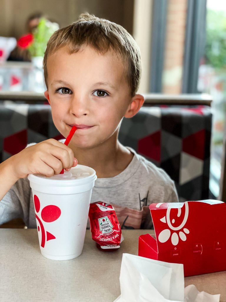 little boy enjoying Chick-fil-a meal