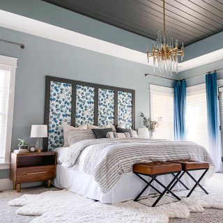 We're you here last fall for this amazing transformation??   Throwing it back to one of the most loved projects of 2020. Our Master Bedroom Makeover!!   And today on the blog I'm sharing all of the details for how I build our faux headboard with peel & stick wallpaper and a few pieces of lumber!  Click the link in my bio to check out the post and make sure to save it to Pinterest for later!  The paint is all @sherwinwilliams   Ceiling/Headboard Trim: Urbane Bronze Wall Color: Eventide  #masterbedroom #beforeandafter #headboard #bedroommakeover #moderneclectic #colorlovedecor #swcolorlove #myhomevibe #myhomestyle #bedroomstyling #bedroomgoals